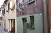 L'arte dei muri dipinti in Emilia Romagna scoperta in 5 passeggiate fotografiche e un concorso